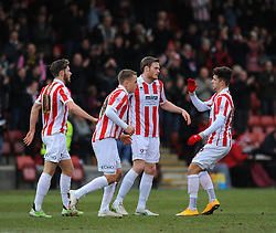 Cheltenham Town's Denny Johnstone celebrates his goal with team mates.  - Photo mandatory by-line: Nizaam Jones - Mobile: 07966 386802 - 14/02/2015 - SPORT - Football - Cheltenham - Whaddon Road - Cheltenham Town v Bury - Sky Bet League Two