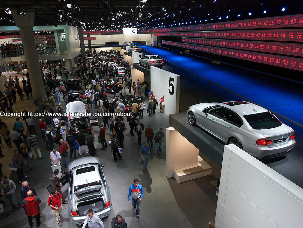 Many visitors at BMW statnd at Frankfurt Motor Show or IAA 2011 Germany