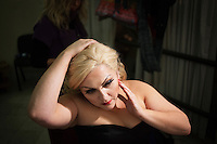 PALERMO, ITALY - 18 JANUARY 2013: Ceri Williams, interpreting Erda in Wagner's Rheingold, check her wig in her dressing room before the start of the opera, at the Massimo Theatre in Palermo, Italy, on January 18th 2013...Das Rheingold is the first of the four operas that constitute Richard Wagner's Der Ring des Nibelungen ('The Ring of the Nibelung'). It was originally written as an introduction to the tripartite Ring, but the cycle is now generally regarded as consisting of four individual operas. Das Rheingold received its premiere at the National Theatre in Munich on 22 September 1869.