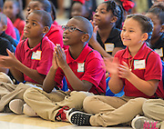 Students listen to the presentation during the Read for the NCAA Final Four kick-off at Blackshear Elementary School, September 24, 2015.