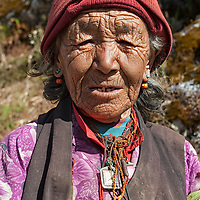 An old woman posing for the camera, somewhere between Namche Bazar and Samde.