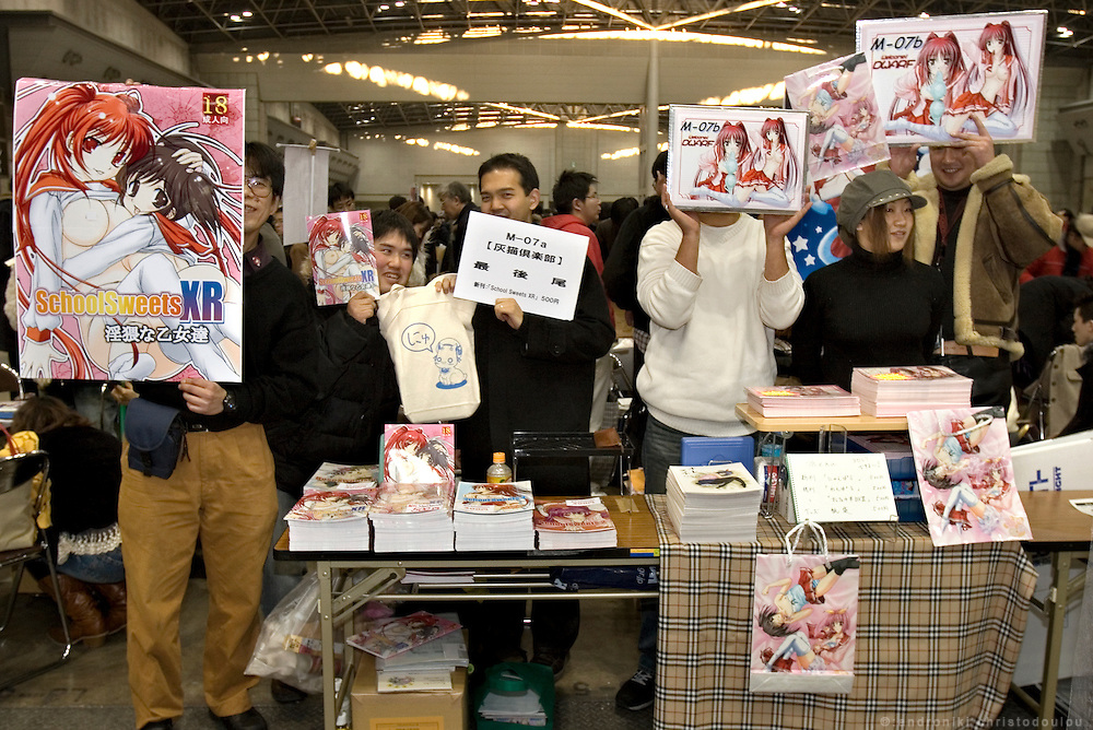 """SCHOOL SWEETS XR"" adult manga stall. TOKYO COMIC MARKET ""COMIKET"" the biggest comic market in Japan. Independent designers come to sell their comics, there is anime, manga, cosplay, toys, posters etc. At ""Tokyo Big Sight"" exhibition center."