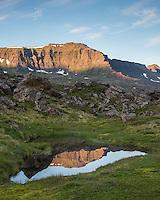 Pond in Stakkahlíðarhraun lava field, Mount Bungufell in background. Loðmundarfjörður, East Iceland.