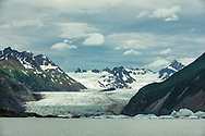 Patchy light on Grewingk Glacier and Lake in Kachemak Bay State Park on the Kenai Peninsula in Southcentral Alaska. Summer. Afternoon.