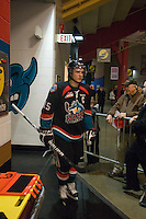 KELOWNA, CANADA, DECEMBER 3: Colton Sissons #15 of the Kelowna Rockets heads to the dressing room as the Prince George Cougars visit the Kelowna Rockets  on December 3, 2011 at Prospera Place in Kelowna, British Columbia, Canada (Photo by Marissa Baecker/Shoot the Breeze) *** Local Caption ***