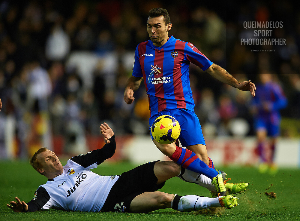 VALENCIA, SPAIN - JANUARY 04:  Jeremy Mathieu (L) of Valencia competes for the ball with David Barral of Levante during the La Liga match between Valencia CF and Levante UD at Estadio Mestalla on January 04, 2013 in Valencia, Spain.  (Photo by Manuel Queimadelos Alonso/Getty Images)
