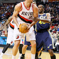 06 December 2013: Utah Jazz small forward Jeremy Evans (40) defends on Portland Trail Blazers center Joel Freeland (19) during the Portland Trail Blazers 130-98 victory over the Utah Jazz at the Moda Center, Portland, Oregon, USA.