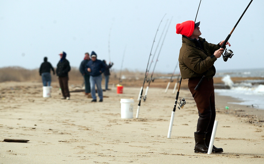 (PPAGE1) Union Beach 4/1/2004 Bassil Chalet of Cedar Grove (right) mans his pole as tries his luck fishing in Union Beach.    Michael J. Treola Staff Photographer....MJT