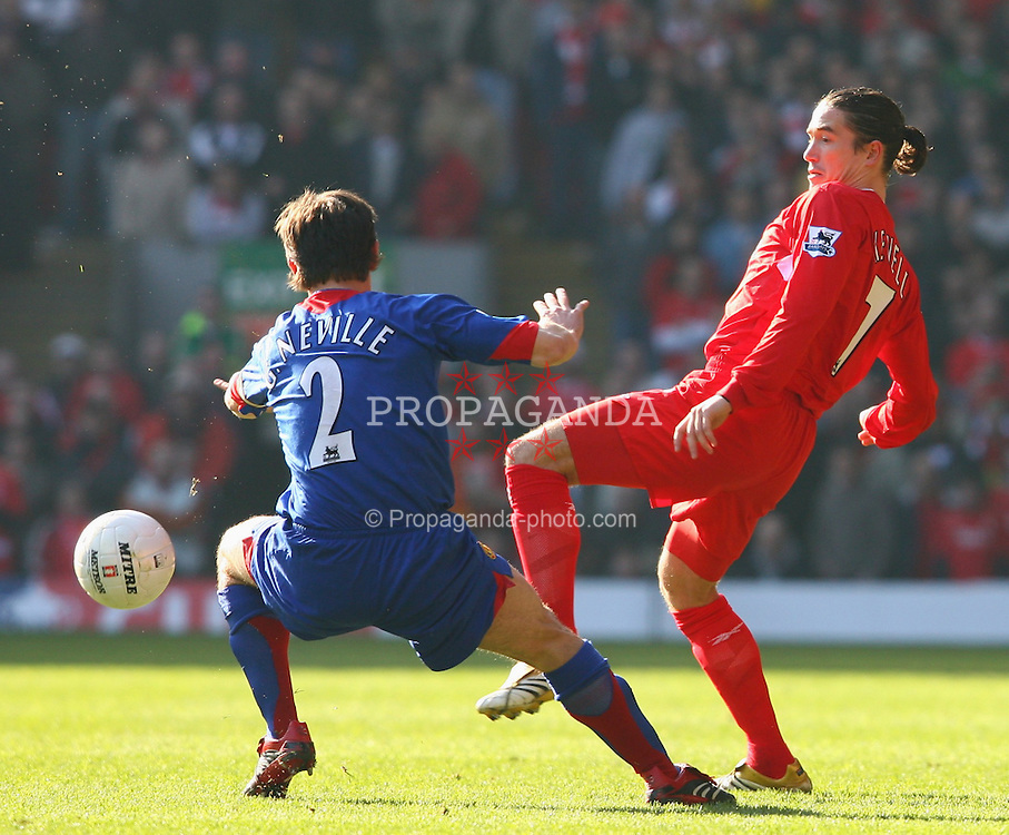 LIVERPOOL, ENGLAND - SATURDAY, FEBRUARY 18th, 2006: Liverpool's Harry Kewell and Manchester United's Gary Neville during the FA Cup 5th Round match at Anfield. (Pic by David Rawcliffe/Propaganda)