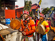 11 MARCH 2017 - KATHMANDU, NEPAL:  Nepali Sherpa Buddhists shamans perform a blessing dance at Swayambhu Stupa. The second most important Buddhist stupa in Kathmandu, Swayambhu Stupa is also a historic landmark and has panoramic views of Kathmandu. It is sacred to both Buddhists and Hindus. The stupa is being rebuilt because it was badly damaged in the 2015 earthquake.   PHOTO BY JACK KURTZ