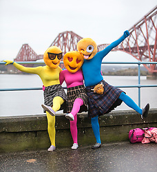 People before the start. The Stoats Loony Dook at South Queensferry, the annual new year dip in the freezing River Forth in the shadow of the world-famous Forth Bridges.