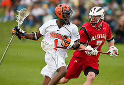 Virginia Cavaliers M  Shamel Bratton  (1) is defended by Maryland Terrapins LSM/Defense Dan Halayko (7).  The #9 ranked Maryland Terrapins fell to the #1 ranked Virginia Cavaliers 10 in 7 overtimes in Men's NCAA Lacrosse at Klockner Stadium on the Grounds of the University of Virginia in Charlottesville, VA on March 28, 2009.