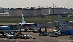 Storage tanks containing jet fuel sit next to the airplane terminal at Schiphol Airport in Amsterdam, the Netherlands, on Tuesday, April 20, 2010. (Photo © Jock Fistick)