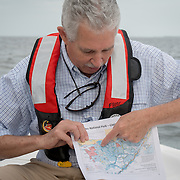 FLORIDA CITY, FLORIDA - APRIL 22, 2016<br /> Robert Johnson, South Florida Natural Resources Center director, holds a printed breakdown of the areas of sea grass affected while riding on  U.S. Parks Service boat in the waters of the Everglades National Park.<br /> (Photo by Angel Valentin)