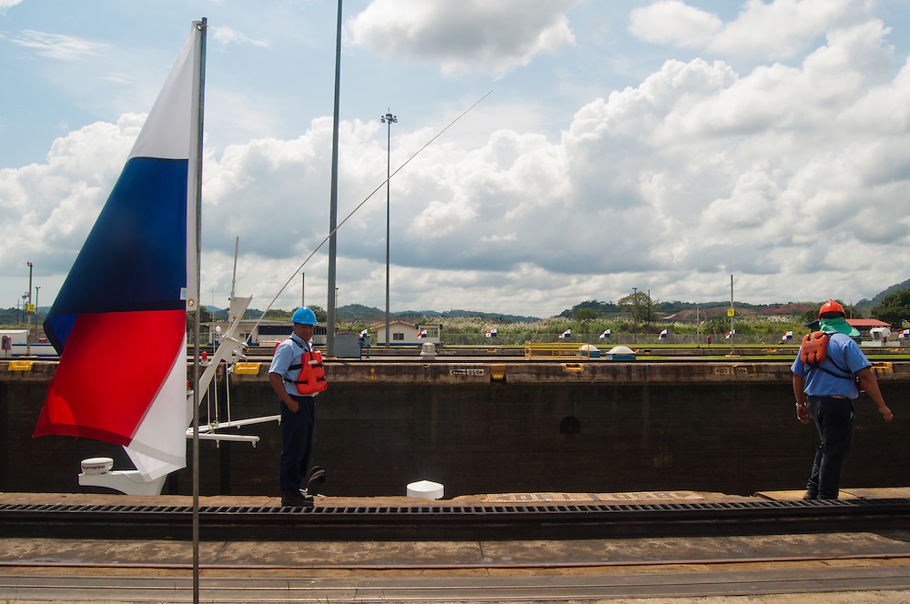MIRAFLORES LOCKS - THE PANAMA CANAL / ESCLUSAS DE MIRAFLORES - EL CANAL DE PANAMA<br /> Photography by Aaron Sosa<br /> Panama City, Panama 2012<br /> (Copyright &copy; Aaron Sosa)<br /> <br /> The Panama Canal is an 77.1-kilometre (48 mi) ship canal in Panama that connects the Atlantic Ocean (via the Caribbean Sea) to the Pacific Ocean. The canal cuts across the Isthmus of Panama and is a key conduit for international maritime trade. There are locks at each end to lift ships up to Lake Gatun (26m (85ft) above sea-level) which was used to reduce the amount of work required for a sea-level connection. The current locks are 33.5m (110ft) wide although new larger ones are proposed.<br /> <br /> Work on the canal, which began in 1881, was completed in 1914, making it no longer necessary for ships to sail the lengthy Cape Horn route around the southernmost tip of South America (via the Drake Passage) or to navigate the dangerous waters of the Strait of Magellan. One of the largest and most difficult engineering projects ever undertaken, the Panama Canal shortcut made it possible for ships to travel between the Atlantic and Pacific Oceans in half the time previously required. The shorter, faster, safer route to the U.S. West Coast and to nations in and along the Pacific Ocean allowed those places to become more integrated with the world economy.