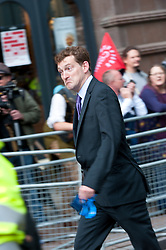 © Licensed to London News Pictures. 05/10/2015. Manchester, UK. Tory delegates run the gauntlet as disabled protesters hurl abuse and plastic balls from the sidelines of the Tory conference venue entrance.A week of pro-peace, anti-austerity, anti-war, anti-Tory, protests dubbed 'Take Back Manchester' has been  organised by The People's Assembly and timed to coincide with the Conservative Party Conference in Manchester on 4th - 7th Oct 2015. Over 40 events are planned, including a speech by new Labour leader Jeremy Corbyn timed to compete with closing speech of Tory leader David Cameron. Photo credit: Graham M. Lawrence/LNP