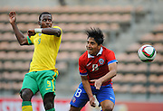CAPE TOWN, SOUTH AFRICA - Sunday 27 September 2015: Luvuyo Mkathana of South Africa and Camilo Moya of Chile during the U17 International friendly soccer match between South Africa v Chile at Athlete Stadium. (Photo by Roger Sedres/ImageSA)