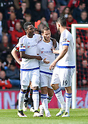 Chelsea players celebrate after Chelsea Midfielder Eden Hazard (10) makes it 0-2 during the Barclays Premier League match between Bournemouth and Chelsea at the Goldsands Stadium, Bournemouth, England on 23 April 2016. Photo by Adam Rivers.