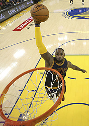 June 2, 2017 - Oakland, California, United States of America - Cleveland Cavaliers forward LeBron James (23) dunks against the Golden State Warriors during the second half of Game 1 of basketball's NBA Finals in Oakland, California. Thursday, June 1, 2017. ERZA SHAW/POOL/PI (Credit Image: © Prensa Internacional via ZUMA Wire)