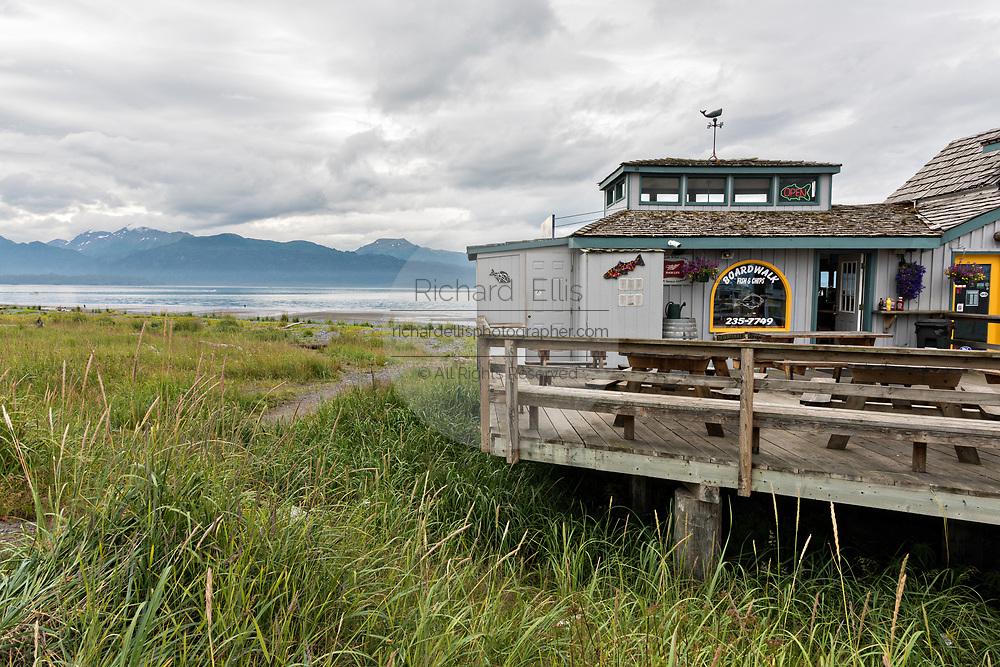 A restaurant along the marsh on Homer Spit on Kamishak Bay in Homer, Alaska.