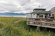 A restaurant along the marsh on Homer Spit on Kamishak Bay in Homer, Alaska.