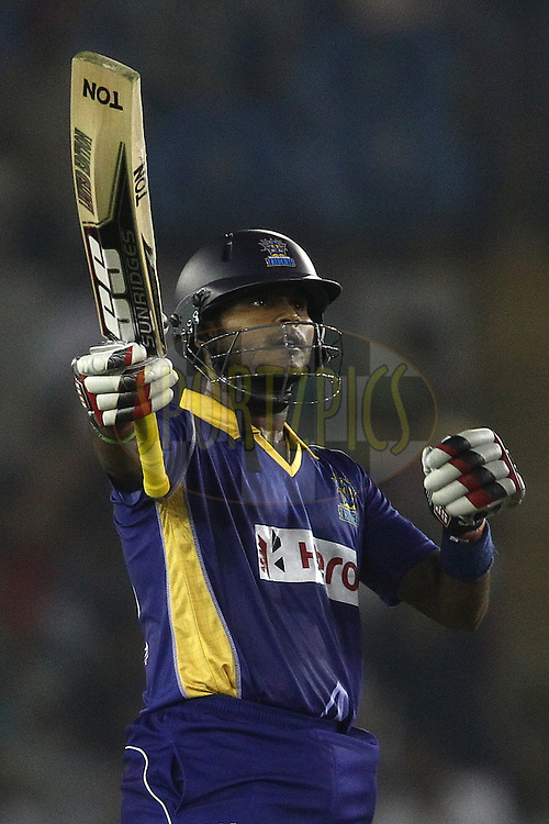 Dilshan Munaweera of the Barbados Tridents raises his bat after reaching his fifty during match 5 of the Oppo Champions League Twenty20 between the Kings XI Punjab and the Barbados Tridents held at the Punjab Cricket Association Stadium, Mohali, India on the 20th September 2014<br /> <br /> Photo by:  Shaun Roy / Sportzpics/ CLT20<br /> <br /> <br /> Image use is subject to the terms and conditions as laid out by the BCCI/ CLT20.  The terms and conditions can be downloaded here:<br /> <br /> http://sportzpics.photoshelter.com/gallery/CLT20-Image-Terms-and-Conditions-2014/G0000IfNJn535VPU/C0000QhhKadWcjYs