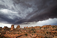 Threatening storm clouds over the Needles District of Canyonlands National Park, Utah, USA.