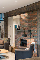 A new home built by SC Smith Building Company is aptly named The Olde Farmhouse and features traditional farmhouse design and uses a mix of reclaimed materials.