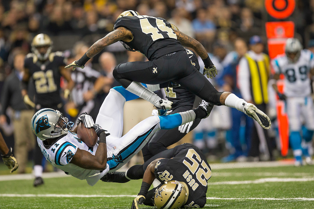 NEW ORLEANS, LA - DECEMBER 30:  Elbert Mack #44 of the New Orleans Saints jumps over the tackle of Brandon LaFell #11 of the Carolina Panthers at Mercedes-Benz Superdome on December 30, 2012 in New Orleans, Louisiana.  The Panthers defeated the Saints 44-38.  (Photo by Wesley Hitt/Getty Images) *** Local Caption *** Elbert Mack; Brandon LaFell