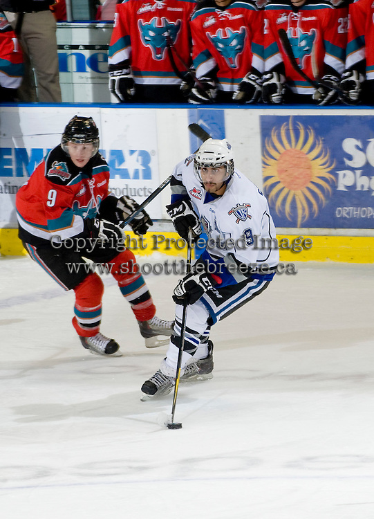 KELOWNA, CANADA, DECEMBER 2: Kevin Sundher #9 of the Victoria Royals skates with the puck while checked by Zach Franko #9 of the Kelowna Rockets as the Victoria Royals visit the Kelowna Rockets  on December 2, 2011 at Prospera Place in Kelowna, British Columbia, Canada (Photo by Marissa Baecker/Shoot the Breeze) *** Local Caption ***