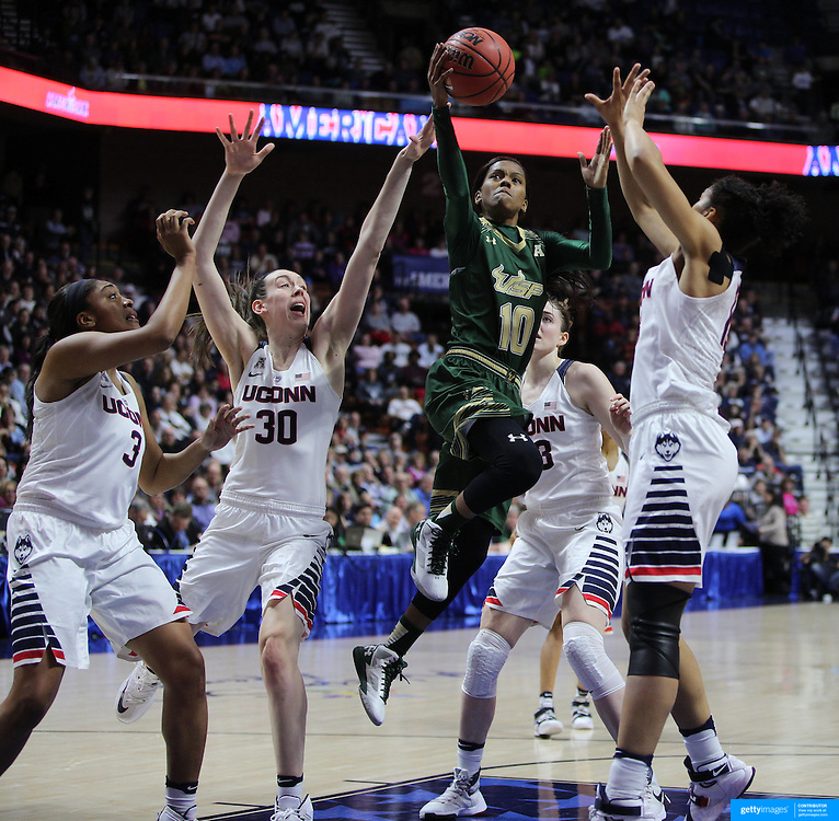 Courtney Williams, USF, drives to the basket defended by Morgan Tuck, (left), Breanna Stewart, Katie Lou Samuelson and Gabby Williams, (right), UConn,  during the UConn Huskies Vs USF Bulls 2016 American Athletic Conference Championships Final. Mohegan Sun Arena, Uncasville, Connecticut, USA. 7th March 2016. Photo Tim Clayton