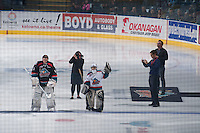 KELOWNA, CANADA - NOVEMBER 22: The Pepsi Save On Foods player of the game waves to the crowd on November 22, 2014 at Prospera Place in Kelowna, British Columbia, Canada.  (Photo by Marissa Baecker/Shoot the Breeze)  *** Local Caption ***