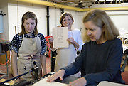 Lindsay Whalen holds her first letterpress print during an emily Davidson workshop. Davidson is a Neighbourhood Spaces artist in residence. Coates is the president of Wndsor Printmakers Forum, location of the workshop.