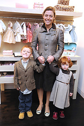 CAMILLA RUTHERFORD and her children HECTOR and MAUD at a party to celebrate the opening of Pincess Marie-Chantal of Greece's store 'Marie-Chantal' 133A Sloane Street, London on 14th October 2008.