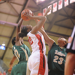Jan 31, 2009; Piscataway, NJ, USA; Rutgers forward Brooklyn Pope (32) has her shot blocked by South Florida center Jessica Lawson (23) during the final minute of South Florida's 59-56 victory over Rutgers in NCAA women's college basketball at the Louis Brown Athletic Center