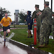 CHICOPEE, Mass -- SEPT 12, 2019 -- U.S. Navy Gunner's Mate 1st Class Cole Disy of Caribou, Maine completes his Navy Physical Readiness as part of the Final Week of Chiefs training. Rain started in the hour before the test and drenched the runners and watchers alike during the execution of the 1.5 mile run test. <br /> Across the U.S. Navy every year, Chief Petty Officers train 1st Class Petty Officers who have been selected for promotion in a summer-long training program. The Final Week, in the week leading up to the pinning ceremony in mid-September, is filled with important training events. <br /> This year, the Greater New England Chiefs Mess met for their first two days of Final Week training at USS Constitution, at Charlestown Navy Yard in Boston. Greater New England Chiefs Mess is made up of Reserve Chiefs from seven Navy Reserve Operational Support Centers, all within four hours drive of Boston. USS Constitution is the world's oldest commissioned warship.  <br /> U.S. Navy Photo by Chief Mass Communication Specialist Roger S. Duncan