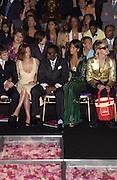 Christina Ricci, Sean P Diddy.  Atelier Versace show, Theatre National de Chaillot. Paris. © Copyright Photograph by Dafydd Jones 66 Stockwell Park Rd. London SW9 0DA Tel 020 7733 0108 www.dafjones.com
