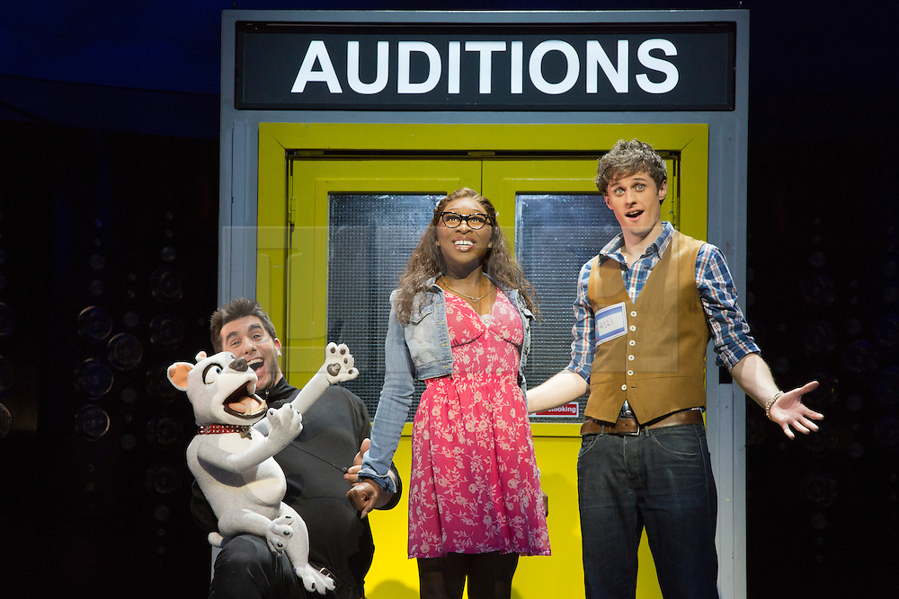 """© Licensed to London News Pictures. 21 March 2014. London, England. L-R: Simon Lipkin as Barlow the Dog, Cynthia Erivo as Chenice and Alan Morrissey as Max. Photocall for the Simon Cowell X-Factor Musical """"I Can't Sing!"""" written by Harry Hill and Steve Brown at the London Palladium. Directed by Sean Foley with Nigel Harman as Simon, Victoria Elliott as Jordy and Ashley Knight as Louis. Photo credit: Bettina Strenske/LNP"""
