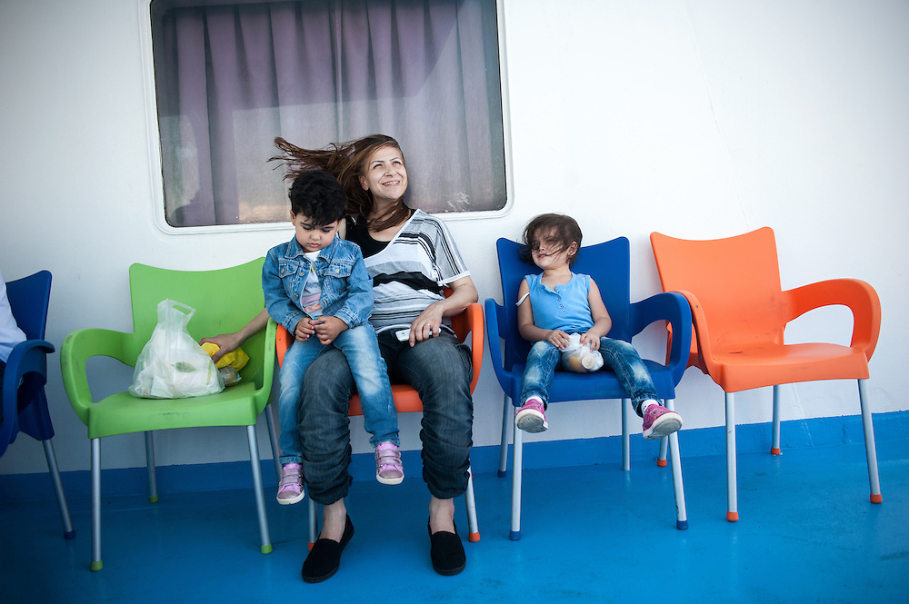Afternoon, Saturday, 12 September 2015. Aysha with her two daughters Bisan 2 ½ (L) and Sham 3 ½ (R) on the deck of F/B Nissos Rodos that took them from Lesbos island to mainland Greece.