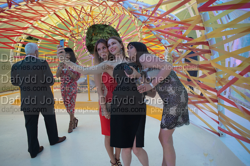 SELFIE; ALINA USPENSKAYA; ANIA SMORODSKAYA; EKATERINA KASHYNTSEVA, Serpentine's Summer party co-hosted with Christopher Kane. 15th Serpentine Pavilion designed by Spanish architects Selgascano. Kensington Gardens. London. 2 July 2015.