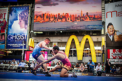 Jun 07, 2012 : Adis Radoncic (winner, in blue) and Cristian Masaya (red) compete in a youth exhibition wrestling match in Times Square as part of the Beat The Streets 2012 Gala and Benefit. Beat The Streets is a New York City-based not-for-profit organization that has brought wrestling to thousands of middle and high school students in the city. Credit:  Rob Bennett for The Wall Street Journal Slug: TSWrestle