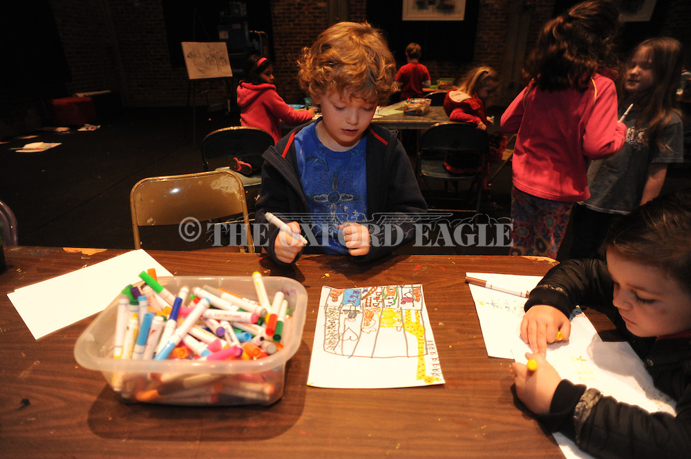 Gavin Leary draws during a spring break art camp at the Powerhouse, in Oxford, Miss. on Thursday, March 13, 2014.