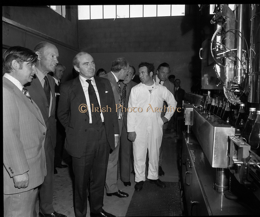 New Bottling plant for D.E.Williams..1975..19.06.1975..06.19.1975..19th June 1975..The Minister for Justice, Mr Patrick Cooney TD, officially opened the new one and a half million gallon per annum soft drink facility at Tullamore,Co Offaly. The new plant represents an investment of over a quarter million pounds by the Williams Group. It is hoped that this investment will create further employment for the area...Image of board members and the Minister watching the operation of the bottling machinery in action. Mr Seamus Keoghan, the machine operator,(white overalls) is on hand to answer questions.