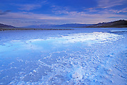 Flooded salt pan under the Funeral Mountains at dawn, Death Valley National Park, California USA