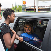 WASHINGTON, DC -JUNE4:  Council member Yvette Alexander (D-Ward 7) talks to her summer interns (L-R) Chakema Coleman, 18, and Amber Baker, 20, outside her campaign office located next to a Shell gas station, June 4, 2016. Alexander is in the fight for her political life as her one time mentor and former Mayor Vincent Gray mounts a comeback, assailing her for poor constituent services, failure to respond to rising crime in the ward and bungling oversight of St. Elizabeths hospital and DC trust. (Photo by Evelyn Hockstein/For The Washington Post)
