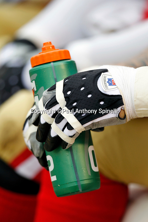 A San Francisco 49ers player holds a drink bottle during the NFL week 17 football game against the Arizona Cardinals on Sunday, January 2, 2011 in San Francisco, California. The 49ers won the game 38-7. (©Paul Anthony Spinelli)