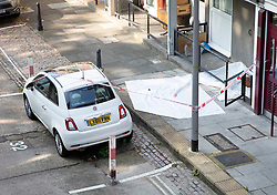 © Licensed to London News Pictures. 13/08/2019. London, UK. Plastic sheeting covers the crime scene at Munster Square in Camden, North London, where a male was stabbed to death last night. The victim, whose age has not yet been released, was pronounced dead at the scene after police were called shortly after 11pm. Photo credit: Peter Macdiarmid/LNP