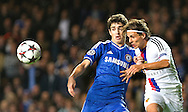 Chelsea's Oscar fights for ball against Basel's Kay Voser  during their UEFA Champions League group match at Stamford Bridge in London, 27 August 2013.  BOGDAN MARAN / BPA
