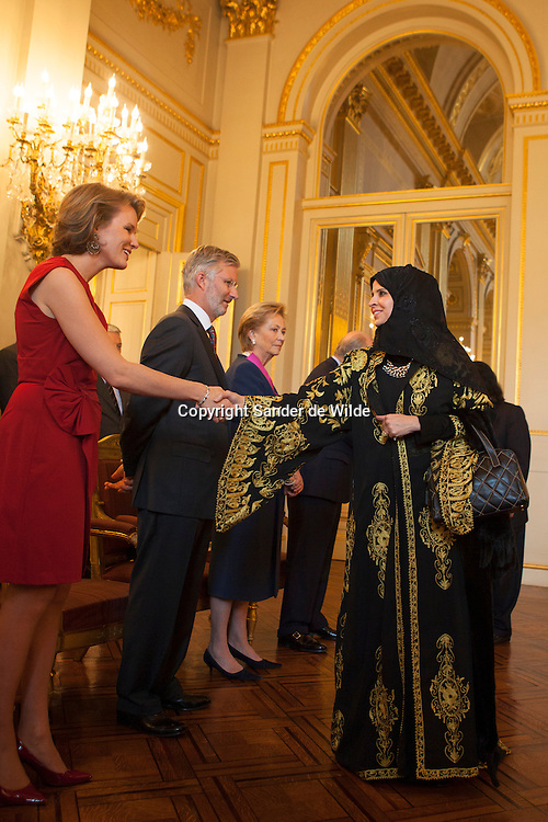 Suleiman Hamed Salem Al Mazroui (not in pic), UAE ambassador to Belgium, and his wife Alia (R) are welcomed by Belgium's Crown Princess Mathilde (L), Crown Prince Philippe (2nd L), Queen Paola and King Albert of Belgium (3rd R) at the start of a traditional New Year reception at the Brussels Royal Palace January 11, 2012.