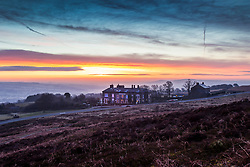 © Licensed to London News Pictures. 14/03/2018. Ilkley UK. Picture shows the Cow & Calf pub at dawn this morning on Ilkley Moor in Yorkshire. Photo credit: Andrew McCaren/LNP